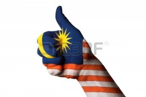 13207919-hand-with-thumb-up-gesture-in-colored-malaysia-national-flag-as-symbol-of-excellence-achievement-goo